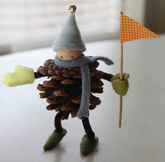 38 Last-Minute Budget-Friendly DIY Christmas Decorations- this cute little pinecone child or make them elves put tiny presents or tiny toy ect. .. make them on a garland or wreath or as ornaments.