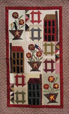 """Painted Daisy Drive, 33"""" x 54"""", quilt pattern at Handmaiden Designs. Churn dash, house and flower basket blocks."""