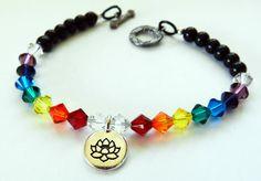 Beautiful Bracelet-Swarovski Crystal Bicones -Chakra Healing Colors-Lotus Flower Charm by rosaliascharm on Etsy
