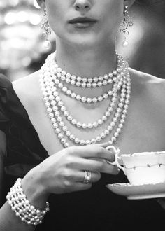 Classy, pearl necklaces & bracelets, dainty tea cup and plate, silver ring and earrings.