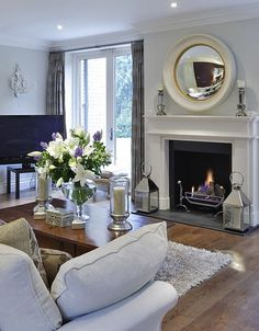 Not only is a fireplace one of the biggest comforts around this time of year, it's also super easy to make it a really classy focal point of your living room using these 9 simple tips.