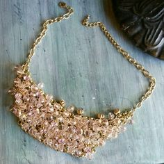 """Stunning statement necklace Add sparkle to any outfit with this bib-style statement necklace in gold and pink. Lobster claw clasp. Chain adjustable up to about 20"""". Perfect condition. Boutique Jewelry Necklaces"""
