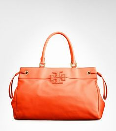 gotta love a handbag in a bright color, this tote from Tory Burch is just perfect!