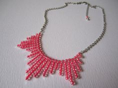 One Of a Kind Handmade Accessories!   Bright Pink Bib Necklace. $18.50, via Etsy.