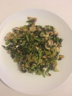 Fry spring onion,green pepper,spinach,celery,mushroom and add sachet of pink salmon.season and serve