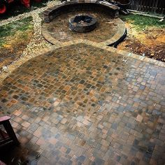 Get ready for chilly nights with your family around a Cambridge Fire Pit! Photo: Omega Landscape