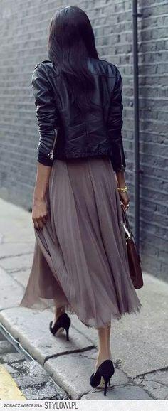 Tough jacket plus feminine skirt plus heels and clutch