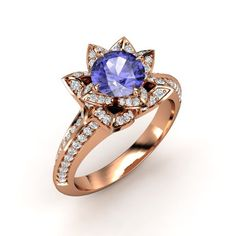The Brilliant Lotus Ring tanzinite and diamonds in pink gold. I would subsitute the pink gold for white gold though