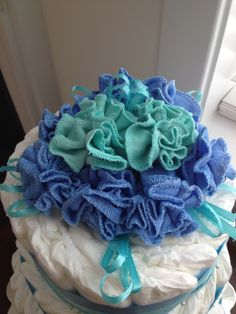 Washcloth flowers for boy baby shower cake topper. Great job on the flowers Mandy! Full cake pictures coming soon!