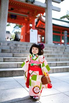 Cute little girl in Japanese traditional outfit. Look at her happy face... its spring time!