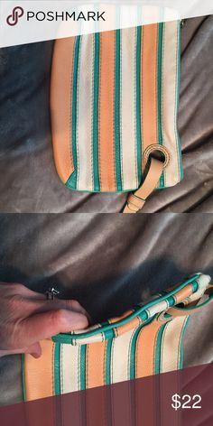 Anthropologie clutch Cute unique clutch with small hand strap. Beautiful leather colors for spring! Anthropologie Bags Clutches & Wristlets
