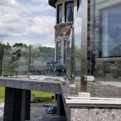 """Thanks to InvisiRail's advanced engineering, their versatile posts are sleek yet strong enough to enable glass panel spacing of a full 6 feet on-center. Get this low-profile system in 36"""" or 42"""" rail height for uninterrupted views from your deck.    #glassrailing #construction #homebuilding #invisirail #beautifulhomes #homedecor #deckdecor Composite Deck Railing, Deck Railing Systems, Glass Railing System, Deck Railings, Outdoor Spaces, Outdoor Living, Deck Decorating, Deck Design, Glass Panels"""