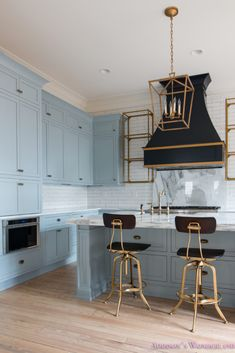 Inside our 1905 Historic Home Restoration Home Tour... classic-vintage-modern-kitchen-blue-gray-cabinets-inset-shaker-black-gold-vent-hood-antique-brass-faucet-white-subway-backsplash-tile-gold-open-shelves