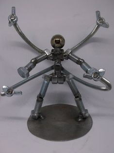 Items similar to Doctor Octopus Figurine, Metal Bolt Figurine, Welded Art, Upcycled Metal Art on Etsy Working Out Area, Welded Art, Metal Figurines, Junk Art, Cycling Art, American Comics, Favorite Person, Paper Weights, Little Gifts