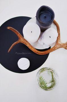 PIKKUPIRTIN // LOTTA on the table: candles, paperball, horn.