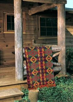 woven throw blanket draped over the porch rails