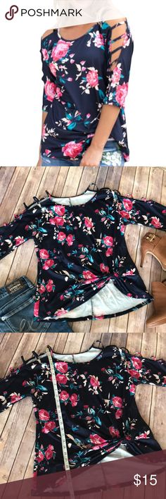 "Navy Blue Floral Ladder Shirt with Knotted Hem This is adorable; I ordered it and I feel like it ran a bit small (would probably better fit a medium- please refer to measurements. Floral pattern on a navy blue background with a ""ladder"" cold shoulder sleeve. Tops Blouses"