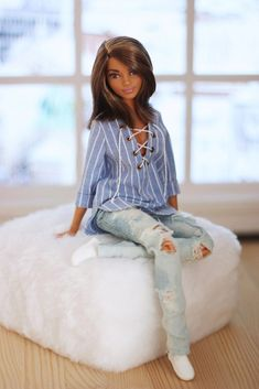 This doll looks like a cross between Halle Berry and Holly Robinson...cute. #FashionDolls