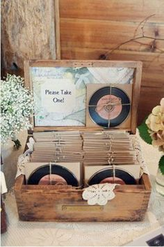 It's a great and relatively inexpensive way to share your wedding memories with guests. I love how this couple, below, made their mix CD's look like vinyl.