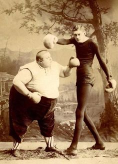 "c. 1900s:  Sideshow boxers- Is it me or does he really look like ""Butterbean""?"