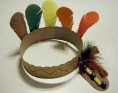 Indian Headbands --- Cut brown construction paper and make sure it's long enough to go around heads, have feathers and glue ready and cut out random shapes with colored construction paper (diamonds, and other jewels) --- Worked really well with high functioning kids, would be a good Pocahontas themed craft and the kids love wearing what they make