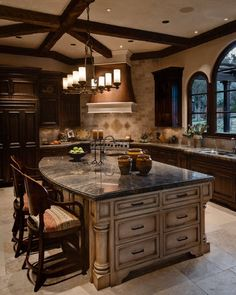 the heart of the home....love the windows. Drawers on the end of the island.