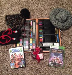 Yaaassss awesome Christmas X3 so pumped up! Got Sims 4, Minecraft Storymode, a briefcase of art supplies, some hats, and some fuzzy socks (also got some other clothes just not showing them) oh and candy! Peppermint bark is my FAVORITE THING EVER X333 *squee* I hope you guys had as amazing as a CHRISTmas as me!! <3
