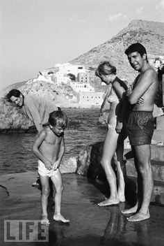 Leonard Cohen and Marriane Ihlen at the Spilia swimming spot on Hydra's main harbour in 1960. The clothed man is George Johnston Australian author (My Brother Jack) ; the youngster is his second son, Jason.