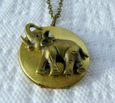 Your place to buy and sell all things handmade Animal Symbols Of Strength, Elephant Jewelry, Good Luck, Locket Necklace, Brass Chain, Elephants, Pocket Watch, Accessories, Etsy