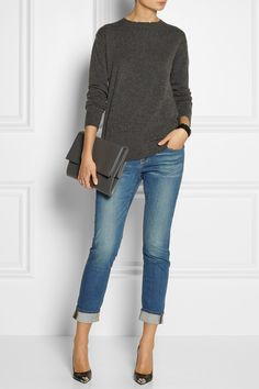 Grey sweater with rolled up cuff jeans paired with black silver-tipped stilettos and a simple clutch. Casual win.