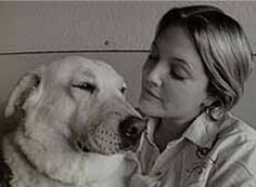 Drew Barrymore and Flossie. Flossie saved her from a late night fire
