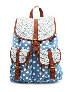 This adorable backpack comes in chambray fabric with a polka dot print and floral lace trimming. Featuring two front pockets with buckles and snap button closures. Snap flap secures a roomy interior with a zipper pocket and adjustable drawstring closure. Fits with adjustable straps at back and a locket loop at the top.