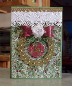 This Christmas card was made using double sided papers, wired ribbon & die cuts are from the Christmas Lace collection by Hot Off the Press. I also used an embossing folder by Anna Griffin and the bow die, which is by Die-namics. The word Joy is die cut using the gold foil paper by Stampin' Up and the die is by HOTP.