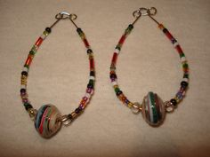 earrings with a paper bead  in the middle