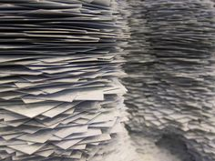 A close up image of the index card sculptures by Tara Donovan, where you can see how each card was stacked individually to create the sculpture.