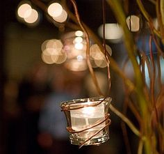 Great idea..votive candle holder wrapped with thick copper wire, hang from trees...to create a sparkling evening effect...