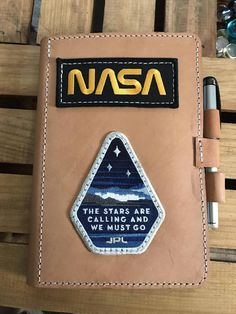Thought you all might enjoy this. A notebook/planner that I made for work : nasa Thought you all might enjoy this. A notebook/planner that I made for work : nasa Filofax, Kunstjournal Inspiration, Nasa Clothes, Pin And Patches, The Martian, Bookbinding, School Supplies, Science Fiction, Nerd