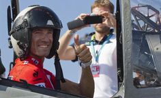 Spain's Alejandro Valverde, poses for a photo inside an AV-8B Harrier II aircraft at the Prncipe de Asturias aircraft carrier, the only one in the Spanish navy's possession, before the start of the third stage of the Vuelta, tour of Spain cycle race, in Cadiz, Spain, on Monday Aug 25, 2014.