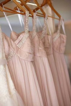 Pretty pink gowns on hangers