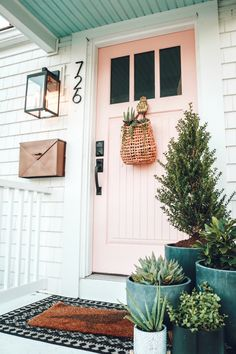 Spring Front Porch Ideas | Nesting with Grace | Some of my favorite ways to freshen the porch for spring with new planters and early spring plants, a pink painted door and welcome mats to usher in your guests! I'm also sharing some of my favorite items from Wayfair! ad #springdecor #entry #porch...