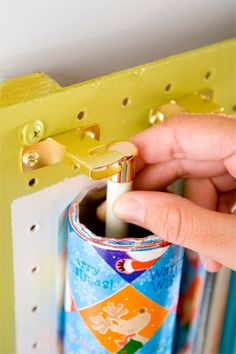 Gift Wrap Station Project: Store bows, paper, tissue, scissors, and tape all in one place with this project.