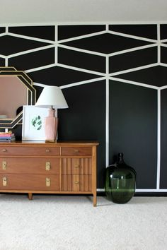 Well Traveled Master Bedroom Makeover Reveal - DO NOT miss this master bedroom! It combines bold black and white, a touch of green, pink and a dash of Palm Beach! STUNNING! Lots of great DIY project ideas for bedrooms in this article! DIY Accent Wall / DIY Painted Patterned Accent Wall / DIY Feature Wall / Black and White Interior Decorating / Black and White Design: