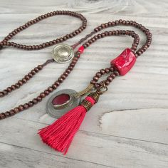 This piece is reserved for Mel with a 15% discount for giving my shop a little facebook love. Thanks Mel! This is a long, bohemian, wooden bead and tassel necklace with Gypsy metalwork and coral accents. A great long beaded necklace for that carefree bohemian look, wear it to remind yourself to be aware of your thoughts and actions or to remind yourself to be present in the moment. These necklaces are inspired by traditional malas but do not have the traditional number of beads. I used ...