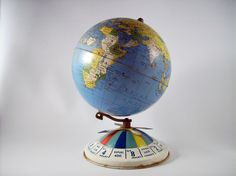 """Air Race Globe, Repogle Globe, 8"""" Globe produced in 1952. The objective was to fly around the world landing at airports identified as red dots on the globe. First to arrive back to the starting point was the winner! The globe itself is metal so you could use your own magnets to mark your past travels or places you would like to visit!"""