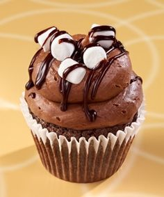 Gigi's Cupcakes - Mississippi Mud: Mississippi Mud cake with coconut & pecans, topped with chocolate marshmallow frosting, marshmallows & ganache.