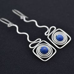 Wire earrings made from hypoallergenic surgical steel wire with beads of lapis lazuli.