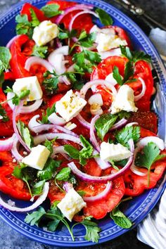 This Tomato Feta Salad is as simple as it gets, and it is super delicious! When ripe, juicy tomatoes are in season you'll want to eat it every day. It contains a few simple ingredients and it comes together in no time at all.