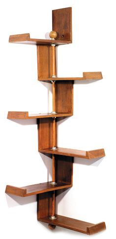 Jacques HITIER (1917-1999)  A corner bookcase formed by large oak shelves of decreasing lenght. Height. 51 1/8 in. - Width. 16 1/8 x 16 1/8 in.  2,500 EUR - 3,500 EUR  /  19 /  £5,611
