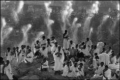 Abbas SAUDI ARABIA. Plain of Arafat. Hajj pilgrimage. Pilgrims from all over the world pray on Mount Rahma. Droplets of water cool off pilgrims. 1992.