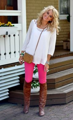 I love this outfit! Bright skinny jeans with boots and a flow-y top! So cute